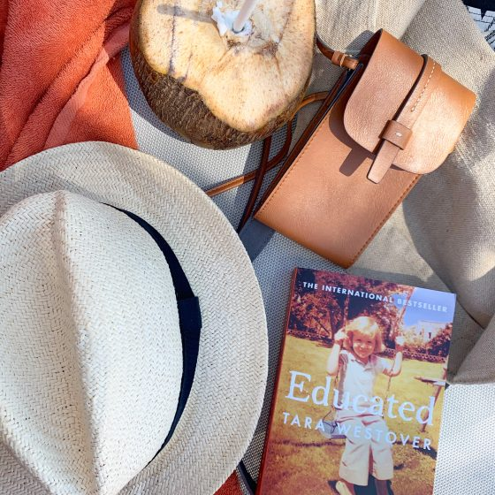 Reading Educated by Tara Westover on the Beach - StefanieGrace.com